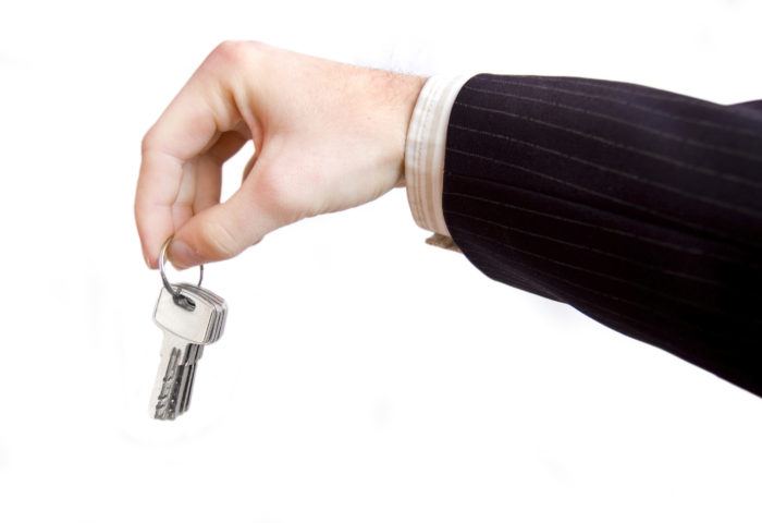 Hand and key conceptual image. Businessman hold the keys.